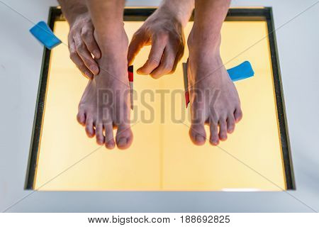 Foot scaning, close up, color image, two people