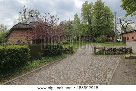 Cobblestone Road And Parish Estate In Hohendorf, Mecklenburg-vorpommern, Germany