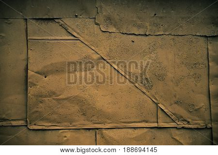 Dark grunge texture: rusty metal surface covered with brown paint flaking and cracking texture with seams and rivets