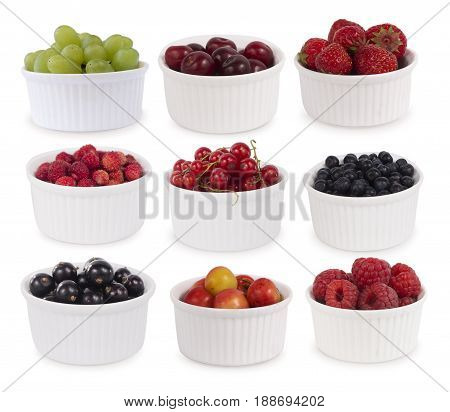 Collage of different fruits and berries isolated on white. Set of strawberries raspberries bilberries currants grapes and cherries. Sweet and juicy berry with copy space for text. Ripe strawberries close-up. Background berry.