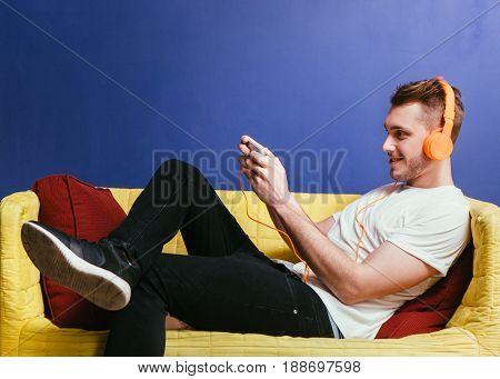 Man Listen Music Game Gamepad Smartphone Rest Leisure Pastime Headphones Phone Background Concept