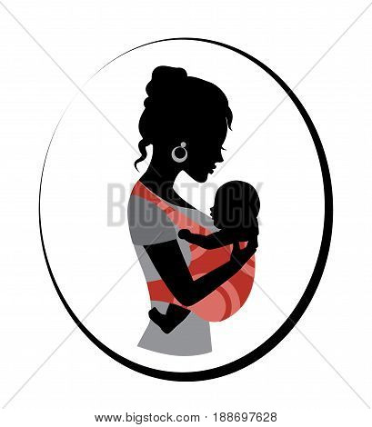 Silhouette of a woman holding a baby in a sling