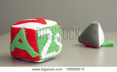 Handmade colorful soft block toy with letters for little children.