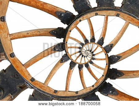 Abstract spiral wooden wagon cannon wheel with black metal brackets, rivets. Wheel wooden spokes fractal background. Horse vehicle wheel pattern two strands spiral background Isolated on white fractal