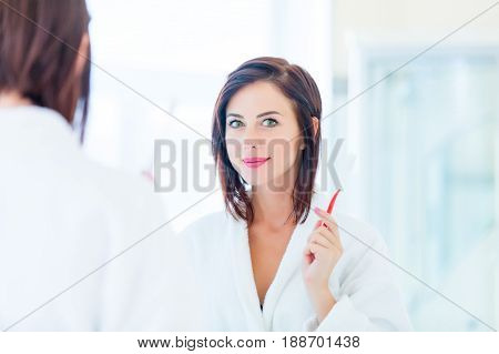 Young Woman With Toothbrush