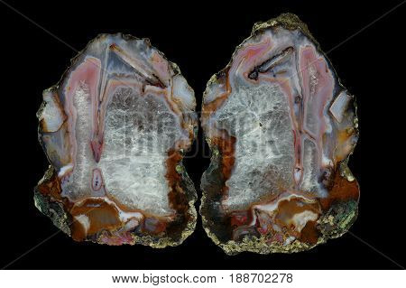 Agate with pseudomorphosis and crystalline quartz. Multicolored silica bands colored with metal oxides are visible. Origin: Asni Atlas Mountains Morocco.