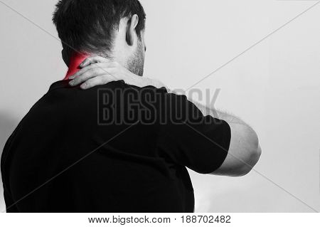 man in black t shirt holding her painful neck back experiencing pain red spot Sport injury tired office work on the white