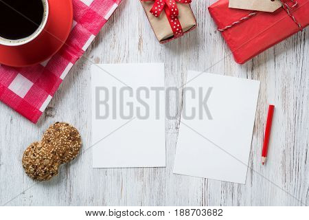 Recipe notebook coffee cup and cookies top view on wooden table