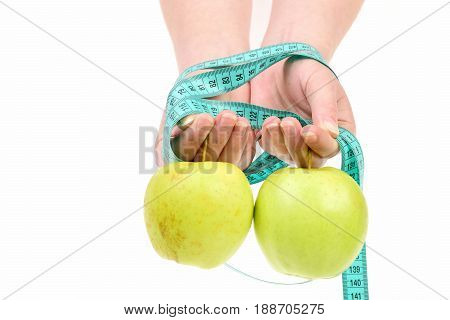 Hands Tied With Greenish Measurement Tape And Green Apples