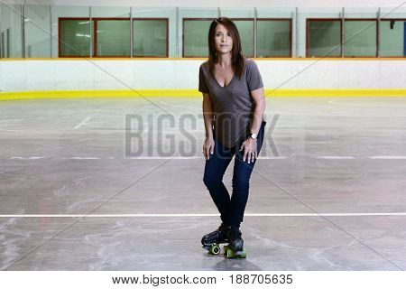 woman doing t stop move on quad roller skates
