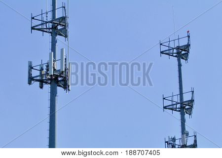 Dual cell towers show against the blue sky.