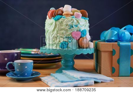 Fathers Day Party Table With Cake And Gifts.