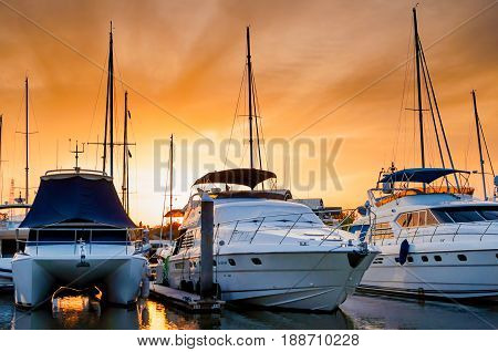 Yacht and boats docking at the marina in the evening Phuket Thailand