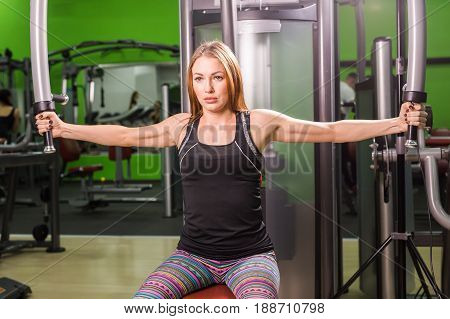 beautiful muscular fit woman exercising building muscles.