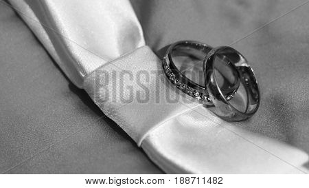 Beautiful Silver Background With Wedding Rings And Stars