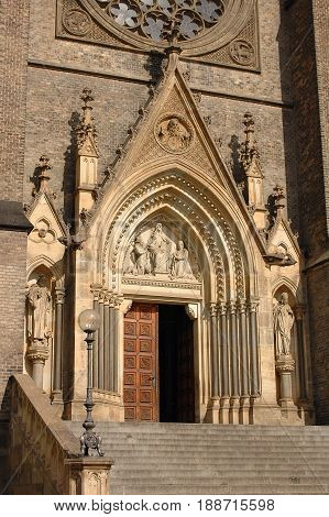 View on main entrance of classic traditional gothic style church with big clock towers. Famous gothic chapel cathedral architecture. Famous Czech holidays vacations sightseeing tours
