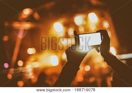 Hand With A Smartphone Records Live Music Festival And Taking Photo
