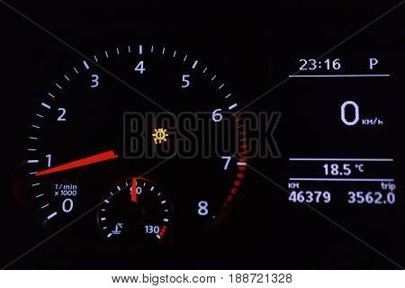 Bright dial speedometer in the dark closeup