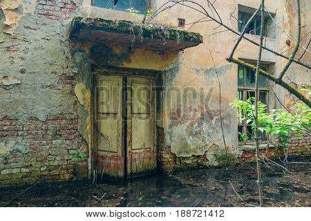 Door of old flooded abandoned house, Voronezh, Russia