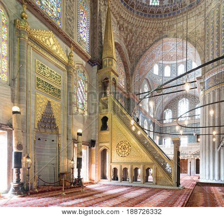 Istanbul, Turkey - April 16, 2017: Marble floral golden ornate minbar (Platform) and niche Sultan Ahmet Mosque (Blue Mosque) Istanbul Turkey