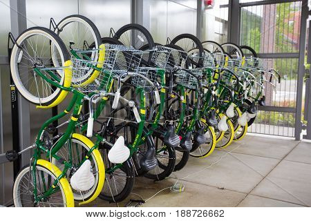 EUGENE, OR - MAY 17, 2017: Bikes hung on a vertical rack as part of a bike share program at the University of Oregon.