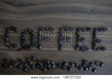 Roasted Coffee Beans, Scattered On The Table And Written Coffee, Brown Texture Of Wood, Wood Backgro