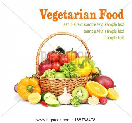 Vegetarian food concept. Fresh vegetables with fruits and basket on white background