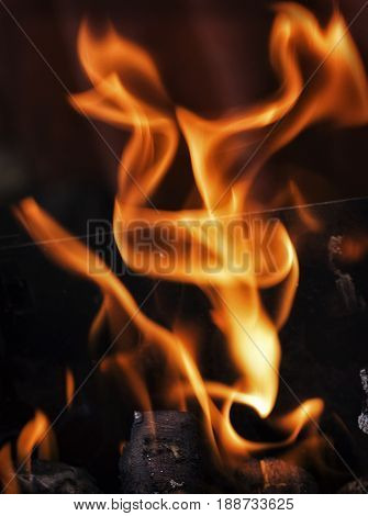 Bizarre flames over burning firewood in the grill