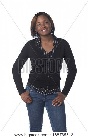 Smiling African American woman with hands in pockets