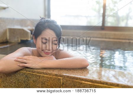 Woman enjoy japanese hot spring