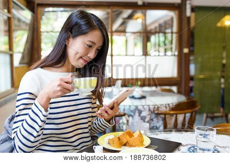 Woman enjoy coffee in cafe