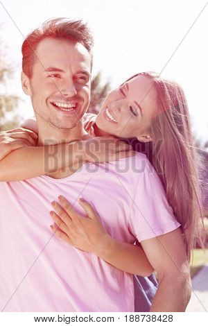 Cheerful young couple enjoying quality time in park