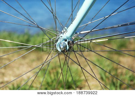 Closeup view of wheel spokes and fork on blurred background