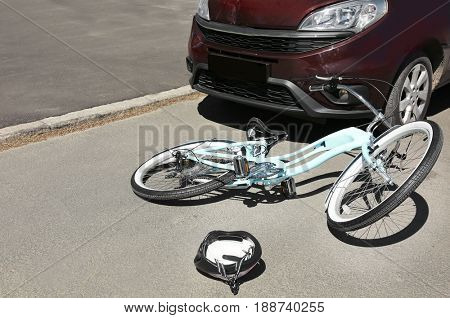 Car and bicycle accident on road of city street