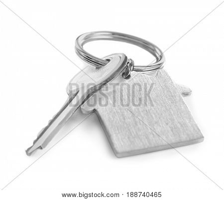Key with trinket on white background. Insurance broker concept