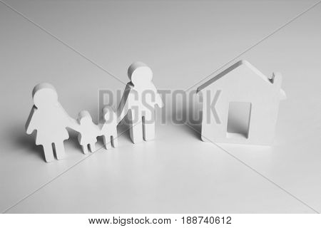 House model and family on white background