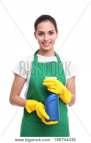 Cleaning concept. Young woman in green apron holding cleanser on white background