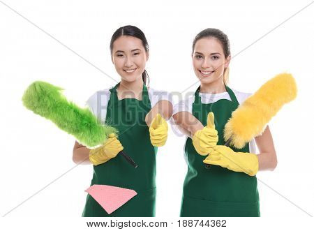 Cleaning service team in green aprons on white background