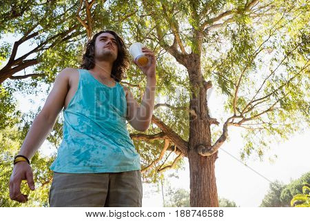 Unconscious man having a beer in the park
