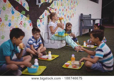 Schoolkids having meal in school