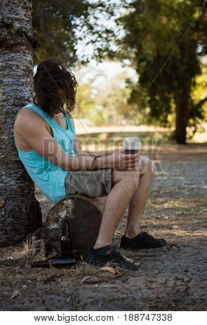 Unconscious drunken man sleeping in the park