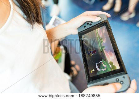 Hong Kong, 19 May 2017 -:Woman holding a Nintendo Switch video game system