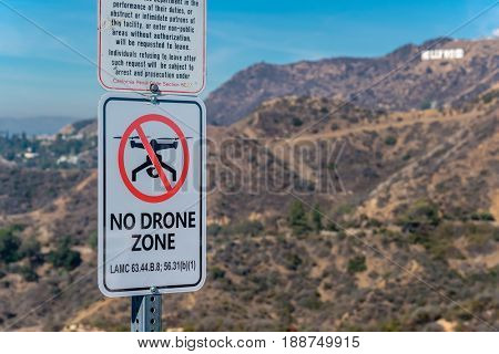 LOS ANGELES, CA - NOVEMBER 07: No drone zone sign at Griffith Park with view at Hollywood,  November 07 2016 in Los Angeles, California, USA.