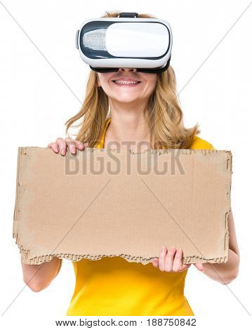 Happy woman wearing virtual reality goggles watching movies or playing video games. Smiling female with VR glasses and corrugated cardboard torn pieces. Girl experiencing 3D gadget technology.