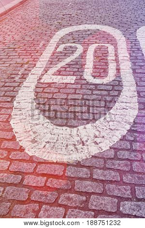 Number 20 painted on cobbled street in London; UK