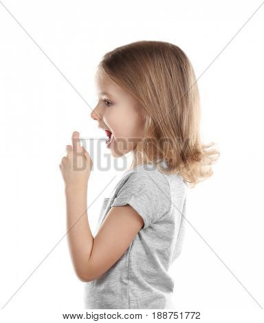 Small ill girl with spray, isolated on white