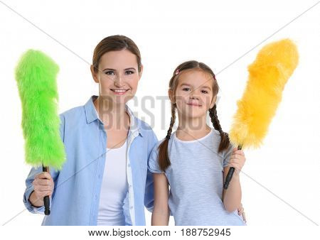 Mother and daughter with dusters, isolated on white