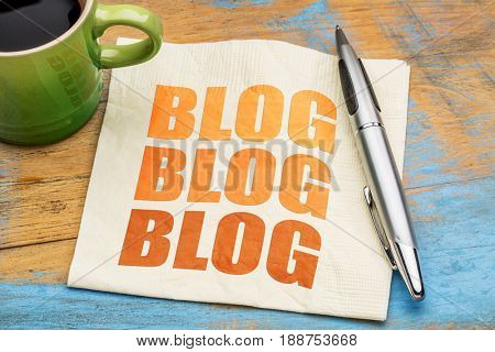 blog word abstract - blogging concept on a napkin with cup of espresso coffee