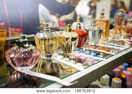 Different perfume bottles in modern shop