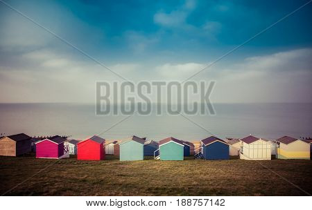 row of beach huts in Tankerton near Whitstable in Kent - British summer